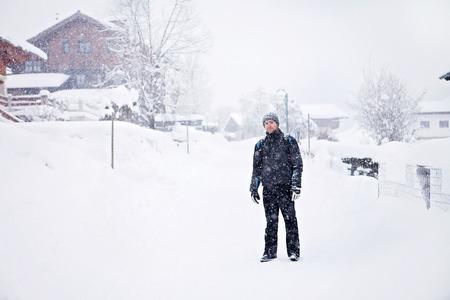 village man: Portrait of young man in snowy village, daytime Stock Photo