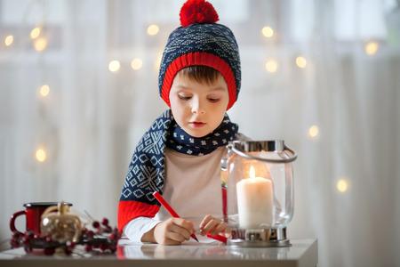 little boys: Adorable little child, boy, writing letter to Santa