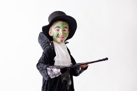 magician hat: Cute boy with painted face as a a magician and dressed in magician costume, having fun, studio shot