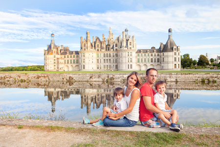 chambord: Happy family on Chambord chateaux, enjoying summer holiday together