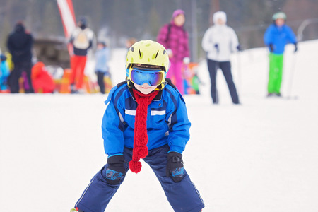 snow ski: Young preschool child, skiing on snow slope in ski resort in Austria, wintertime Stock Photo