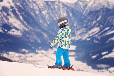 ski mask: Young preschool child, skiing on snow slope in ski resort in Austria, wintertime Stock Photo