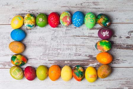 festive food: Colorful easter eggs on rustic wooden background Stock Photo