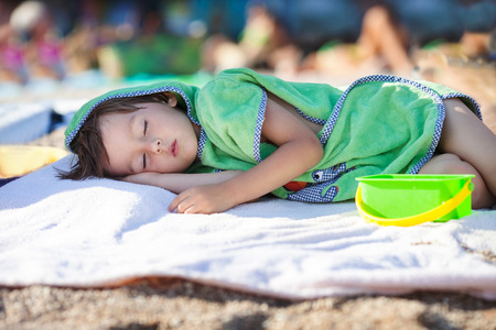 boy  naked: Little baby boy, sleeping on the beach in the afternoon, wrapped in towel