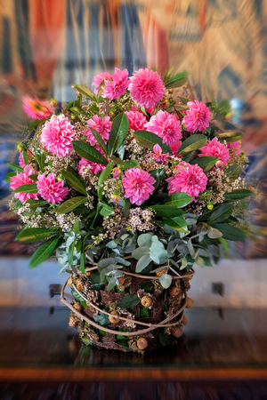extravagant: Beautiful extravagant vase with a bouquet pink flowers on a rustic table Stock Photo