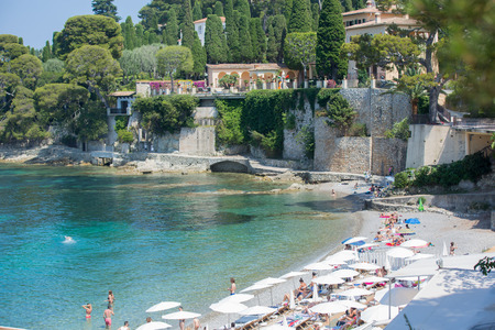 CAP FERRAT, FRANCE  - 27 JUNE 2016 : Cote dAzur France. View of luxury bay of French riviera. Cap Ferrat beach is situated between Nice city and Monaco, mediterranean Sea Editorial