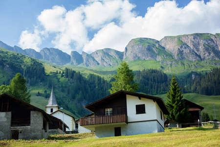 swiss alps: Landscape view of a little village in Swiss Alps on sunset, Switzerland Stock Photo