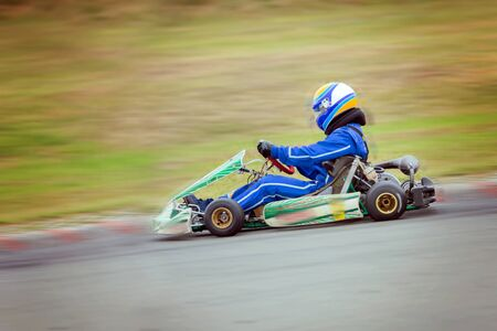 Go-cart racing driver, driving fast, panning effects Stock Photo