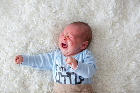 Little newborn baby crying, baby with skin rash, child dermatitis symptom problem rash, newborn suffering atopic symptom on skin. concept child health