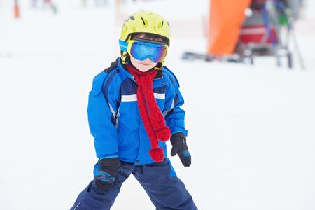 Young preschool child, skiing on snow slope in ski resort in Austria, wintertime Stock Photo