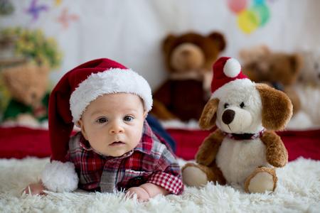 Christmas Portrait Of Cute Little Newborn Baby Boy Dressed In