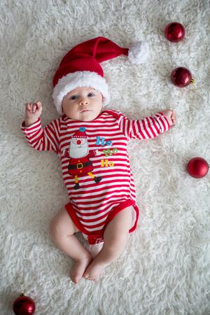 Christmas Portrait Of Cute Little Newborn Baby Boy Wearing Santa