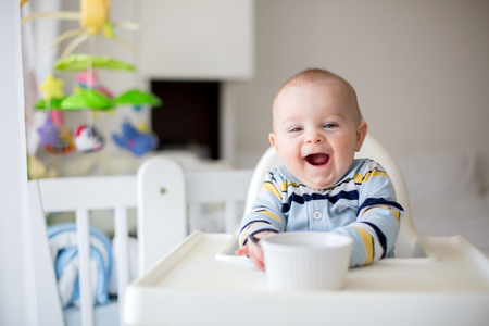 Cute little baby boy, eating mashed vegetables for lunch, mom feeding him, sweet toddler boy, smiling Stock fotó - 96794866