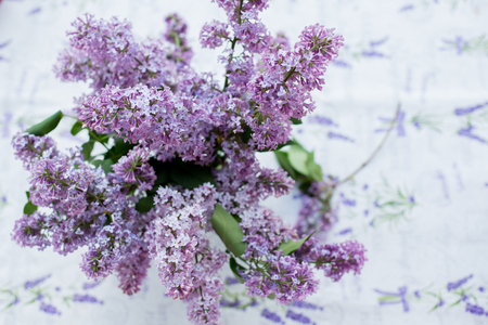 Lilac bouquet in a vase on a table