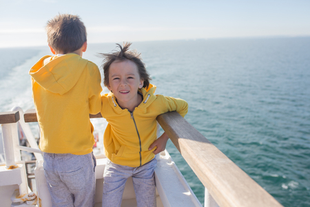 Happy family, traveling on vacation on board of cruise, outdoor on the deck, summertime Stok Fotoğraf