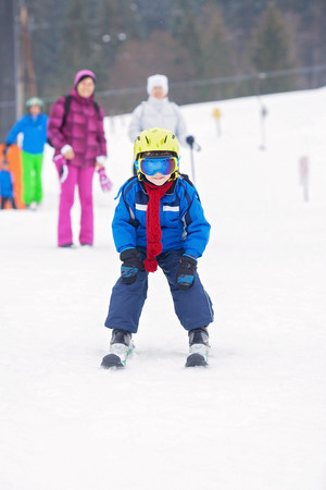 Young preschool child, skiing on snow slope in ski resort in Austria, wintertime 스톡 콘텐츠