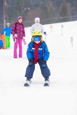 Young preschool child, skiing on snow slope in ski resort in Austria, wintertime Imagens