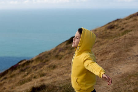 Beautiful boy, Enjoying the nature, the wind and the ocean of North Devon, Exmoor park