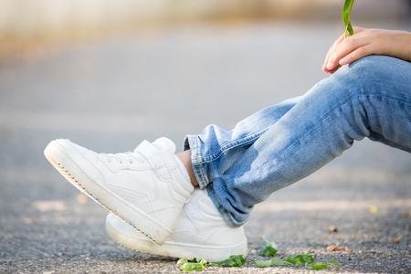 Sneakers on kids feet, outdoors
