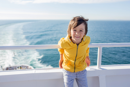 Happy family, traveling on vacation on board of cruise, outdoor on the deck, summertime Фото со стока