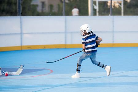 Children playing field hockeyball on playground