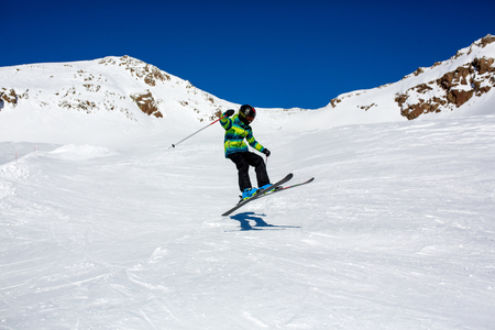 Happy people, children and adults, skiing on a sunny day in Tyrol mountains. Kids having fun while skiing 版權商用圖片