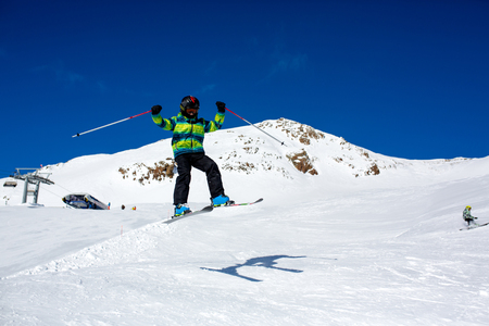 Happy people, children and adults, skiing on a sunny day in Tyrol mountains. Kids having fun while skiing Stock fotó