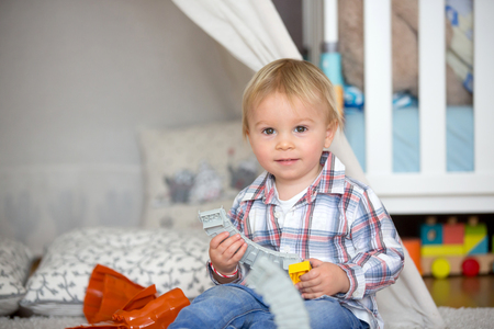 Child toddler playing with construction toys at home or nursery Stockfoto