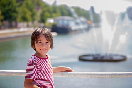 Little boy on a bridge in Town of Troyes, streets and buildings, landmarks Stock Photo