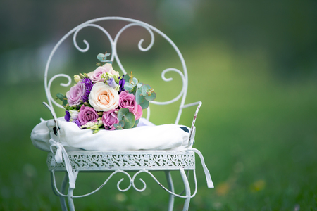 Flower bouquet for mothers day on a beautiful vintage chair in a park 스톡 콘텐츠