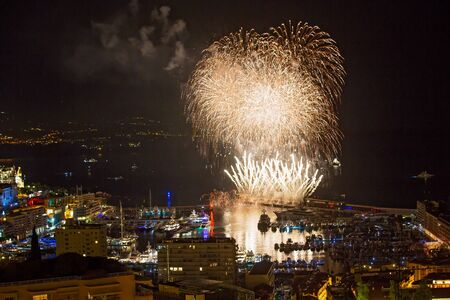 Panoramic lovely view of fireworks on the Principality of Monaco on a stormy day
