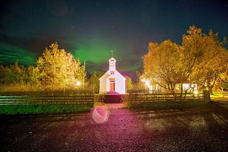 Beautiful landscape with Aurora borealis taken in Iceland on a clear sky night, dancing northern lights Stok Fotoğraf