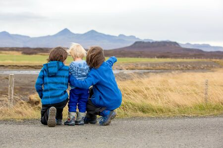 Children, playing on a road near non active vulcano in Snaefellsjokull National Park, iceland autumntime 写真素材