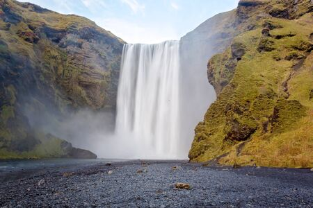 Beautiful view of the Skogafoss waterfall in Iceland on a sunset cloudy day, autumntime 写真素材 - 131929347