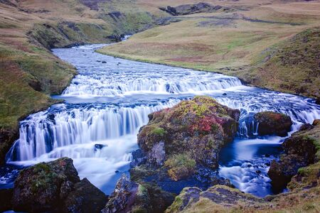 Beautiful view of the Skogafoss waterfall in Iceland on a sunset cloudy day, autumntime 写真素材 - 131929624