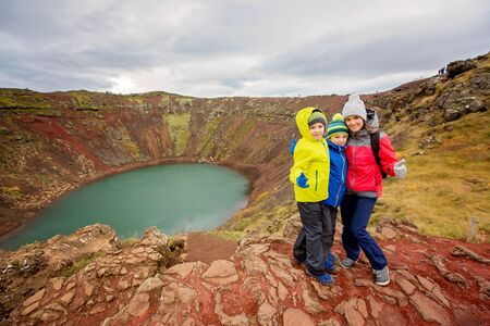 Children, boys, posing in front of Kerid crater lake in Iceland, autumntime 版權商用圖片