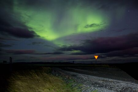 Beautiful landscape with Aurora borealis taken in Iceland on a clear sky night, dancing northern lights Banque d'images