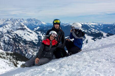 Family in winter ski resort on a sunny day, enjoying scenery landscape