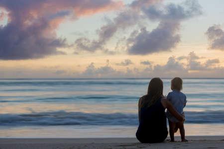 Happy beautiful fashion family, children, casually dressed, enjoying the sunrise on the beach in Mauritius, famiy joyful vacation