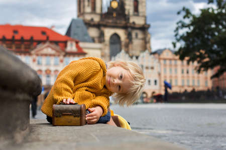 Cute child, boy, visiting Prague after the quarantine Covid 19, empty streets 免版税图像