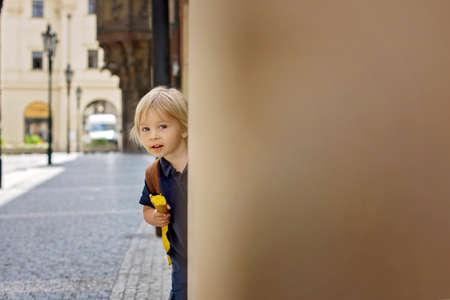 Cute child, boy, visiting Prague after the quarantine Covid 19, eating ice cream, empty streets Фото со стока - 151122304