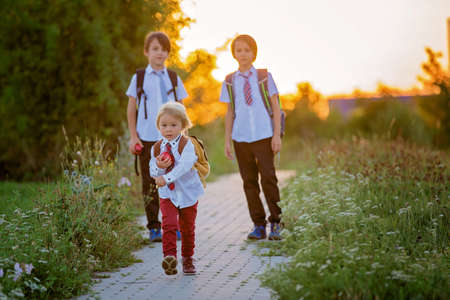 School children, boys, going back to school after the summer vacation, kids going to school