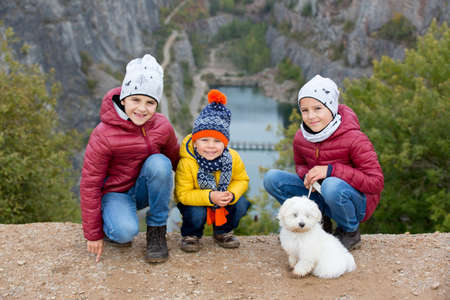 Children, posing in front of a stone quarry in Czech, called Big America near Prague