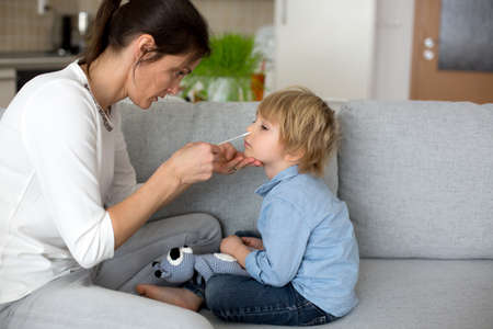 Mother, testing her child for  at home, making home allowed swab tests to prove negative result