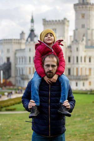 Happy family, relaxing in the park in front of beautiful renaissance castle Hluboka in the Czech Republic