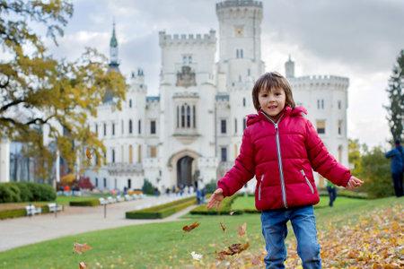 Cute child, preschool boy in front of beautiful renaissance castle Hluboka in the Czech Republic