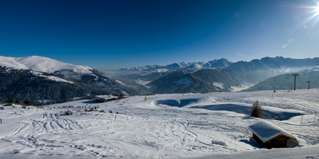 skie: winter panorama with Skislopes at the austian alps