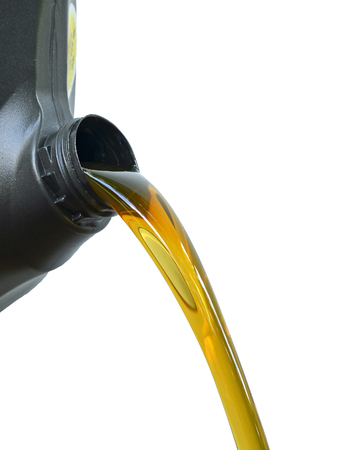 gallons: Pour of oil from the gallons Black.White background.Clean fuel has not been used.