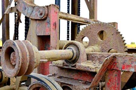 meshing: cog belt of the machine is filled with mud. Stock Photo