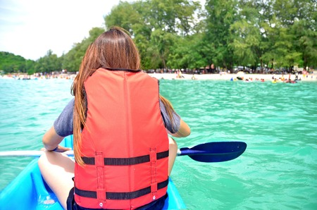 Woman Canoeing in Sai Kaew beach, Sattahip, Chon Buri, Thailand.